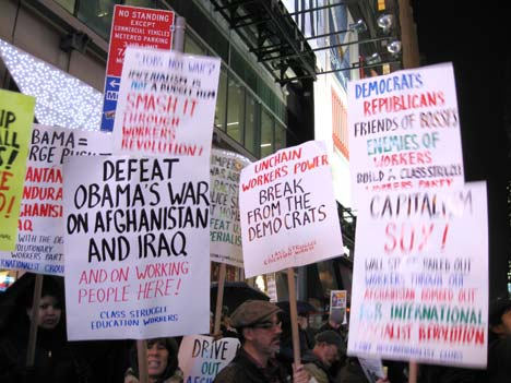 Internationalist contingent at December 2 Times Square New York City protest over U.S. escalation of war on Afghanistan. (Internationalist photo)