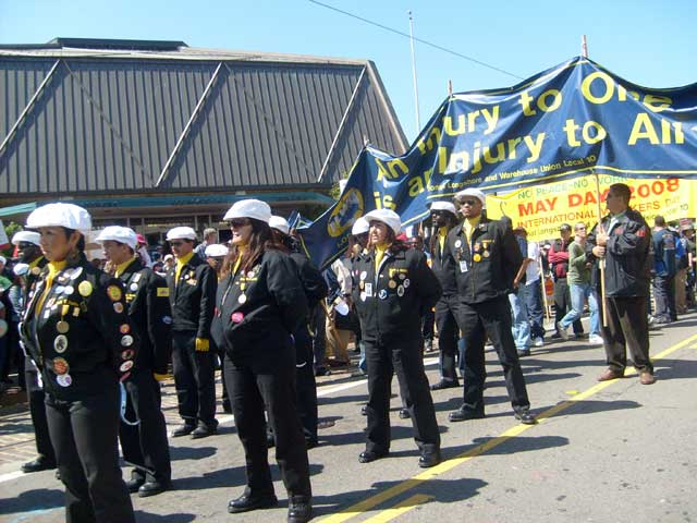 ILWU drill team at May Day march, 080501. Internationalist photo