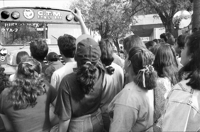"Women workers of the Sony subsidiary               Magnéticos de México in Nuevo Laredo repel attempts by               ""union"" bureaucrats of the corporatist CTM to bring in               scabs in buses during April 1994 strike. (photo: Fred               Chase/Impact Visuals)"