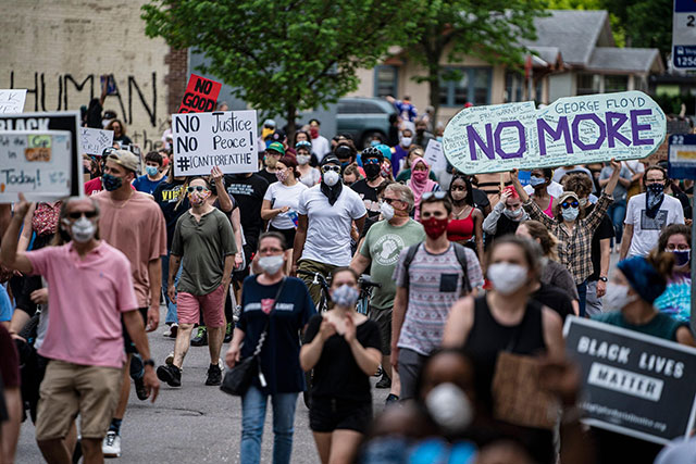 Thousands march from site where George Floyd was killed             to Minneapolis Police Department's 3rd Precinct, 26 May             2020. (Photo: Carlos Gonzalez / Star Tribune)