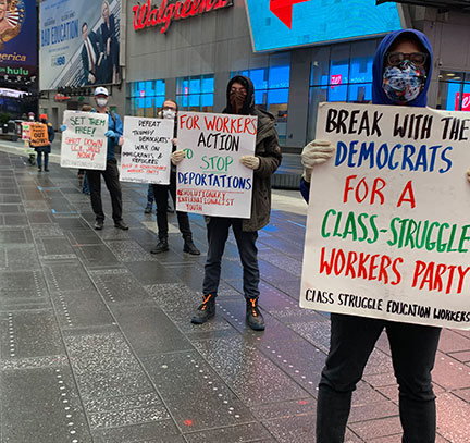 Internationalist protesters in NYC's Times Square call             to close I.C.E. concentration camps, 24 April 2020.