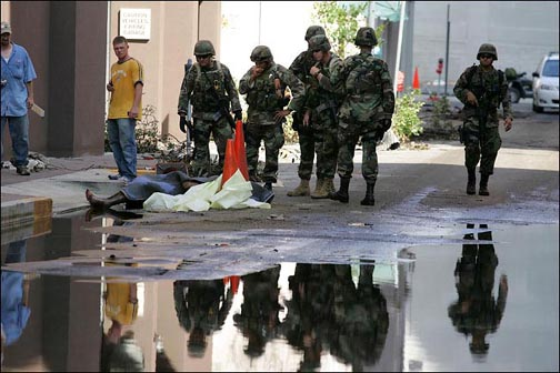 Troops with corpse in New Orleans, 7 Sept. 2005