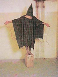 Iraqi prisoner being tortured at Abu Ghraib